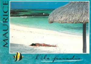 Mauritius snail stamp franking on postcard paradise island sunbathing