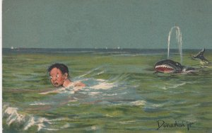 DONADINI ;  Fish with teeth chases swimming man , 1908