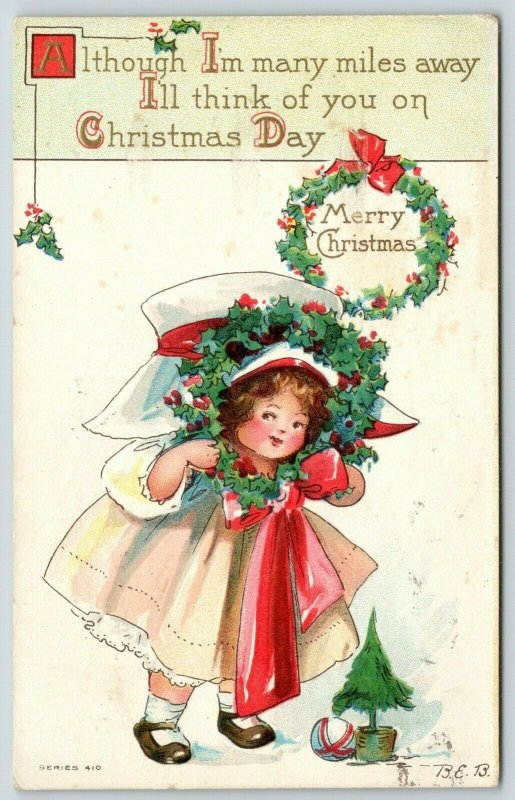 Bertha E Blodget Christmas~Little Girl Puts Face in Holly Berry Wreath~Big Hat