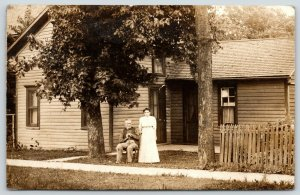 Beaverville IL Dufrain~Older Couple Front of Simple House~Picket Fence~1912 RPPC