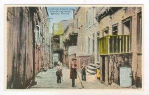 Petite rue Sous-le-Cap, Quebec, Canada, 1910s  child sweeping street