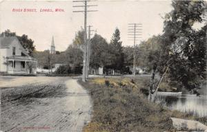 Lowell Michigan~River Street~House~Church Steeple~Boat on River~c1910 Postcard