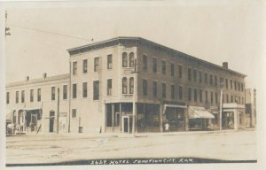 RP: JUNCTION CITY , Kansas , 1900-10s ; Street view , Hotel