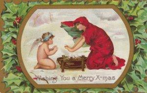 CHRISTMAS , angel keeping warm in snow , 00-10s