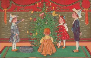 A Merry CHRISTMAS, 1909; Children decorating tree
