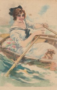 USABOL ; Woman rowing a boat , dog , 00-10s