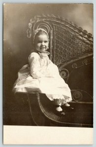 RPPC Doris Damon* What a Smile, Baby! On Elegant Wicker Chair Arm~Low-Key 1910