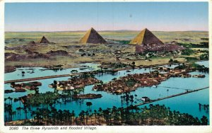 Egypt The Three Pyramids and Flooded Village 05.36