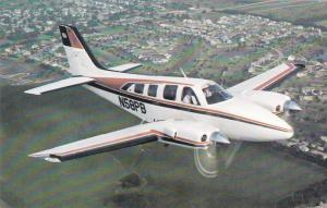 Beechcrcft Baron 58P in flight, 40-60s