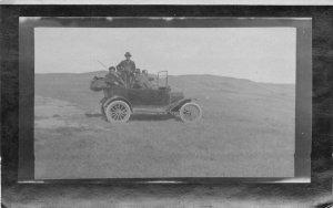 Automobile Trip hunting Shotguns C-1910 RPPC Photo Postcard 20-1250