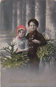 Christmas Greetings, Girl & Boy holding small pine trees, posing for picture,...