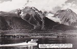 RP; Motor boat on Cathlyn Lake and Hudson Bay Mountain, Smithers, B.C., 1930s