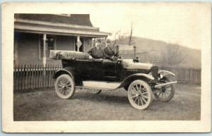 c1920s  RPPC Real Photo Postcard Two Young Ladies in Uniform, Driving Automobile