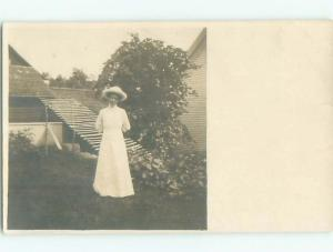 rppc 1920's WOMAN POSING BEHIND THE HOUSE AC8718