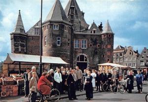 Netherlands Amsterdam Nieuwmarkt met Waaggebouw Market Place Cyclists