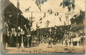 Vintage 1907 COOPERSTOWN, New York RPPC Real Photo Postcard Main Street / Flags