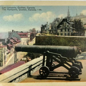The Ramparts Quebec Canada Colored Canons Building Postcard Vintage
