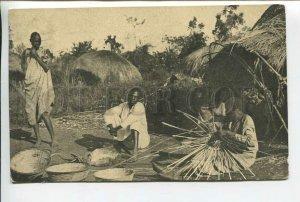 438994 British Africa UGANDA natives at basket work Vintage RPPC