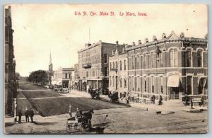 LeMars IA~Telephone Co~Musrach? Wagon~Boys @ Basement Barber~Church Steeple 1910