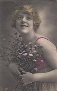 TUCK # 4858, 00-10s ; Blonde Woman Holding Flowers
