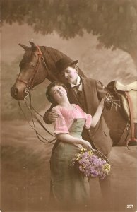Couple. Romance with their horse Nice old vintage Enmglish postcard