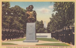 ANNAPOLIS, Maryland, 1930-40s; Midshipmen pass Tecumseh Monument, returning f...