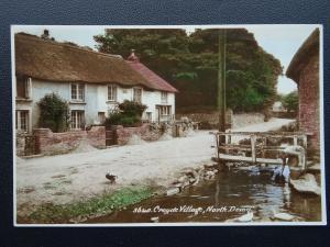 Devon CROYDE VILLAGE shows Foot Bridge & Women Filing Pail  - Old RP Postcard