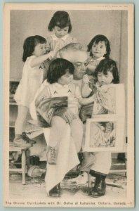 Callander Ontario~Dionne Quintuplets Climb on Dr Dafoe~Reading Books~c1937 PC