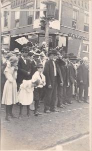 Toledo Iowa~Patriotic Parade~Crowd on Sidewalk~Savings Bank~Flags~1912 RPPC