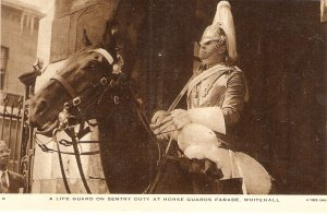 A Life Guard on Setry Duty..Horses Tuck Real Photograph Postcard