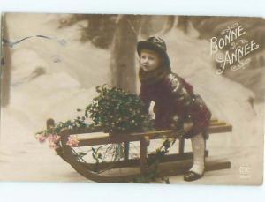 tinted rppc c1910 GIRL ON SLED AC8972