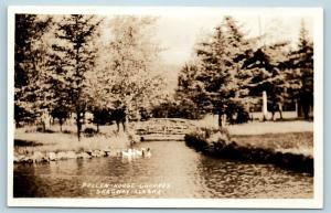Postcard AK Skagway Pullen House Grounds Duck Pond RPPC Real Photo Q12