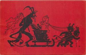 Holidays Christmas KRAMPUS Devil family baby cherub angel on sleigh silhouettes