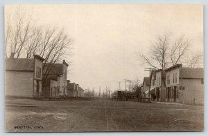 Grafton Iowa~Main Street~Stores on Both Sides Wide Dirt Road~Wagons~c1910 RPPC