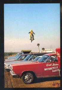 EVEL KNIEVEL MOTORCYCLE DAREDEVIL JUMPING CARS POSTCARD ADVERTISING COPY