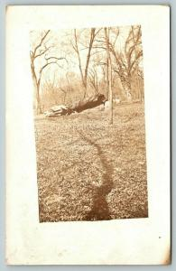 Wellman IA~Spill? Line To Fallen Tree in Park~Real Photo Postcard~RPPC 1913 PC