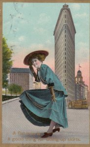 NEW YORK CITY , 00-10s ; Woman & flat Iron Building