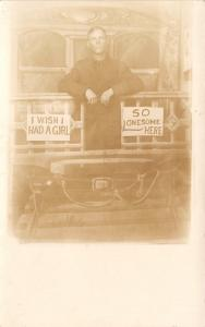 Real Photo Postcard Studio Shot~Young Man~Train Caboose~Wish I Had a Girl~1912
