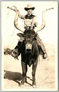 COWBOY RIDING BUFFALO ANTIQUE REAL PHOTO POSTCARD RPPC