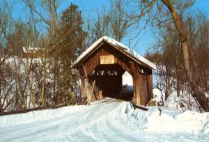 VT - Stowe. Old Covered Bridge Spanning Gold Brook at Stowe Hollow (Vermont)