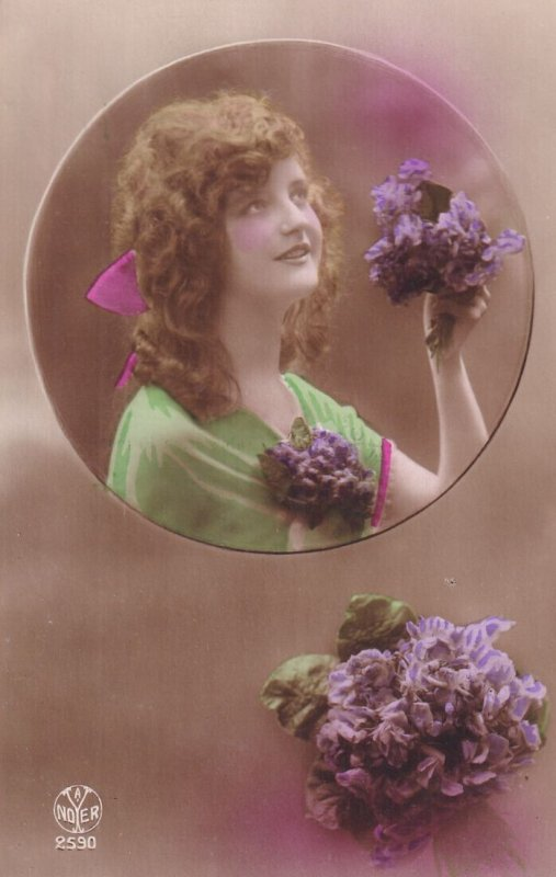 RP: Young Lady wearing gren dress holding bouquet of purple flowers, 1900-10s