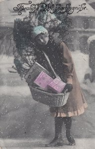 CHRISTMAS, PU-1921; Girl carrying small tree and basket of gifts in snow fall
