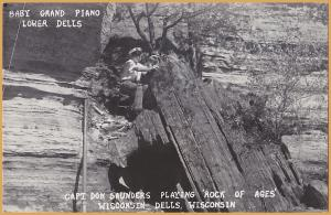 RPPC-Baby Grand Piano, Lower Wisconsin Dells-Capt. Don Saunders Playing Rock of