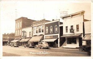 G21/ Plainwell Michigan RPPC Postcard 1941 Stores Autos Sweet Shop