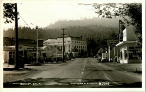 Vtg Postcard RPPC Quincy CA Eastman's Studio B-7946 Street View Chevy 76 Signs