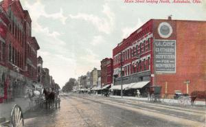 Ashtabula OH~Lady Enters Globe Men & Boys Clothier~Billboard~Wagon Wheel~1914
