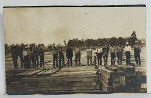 Rppc Occupational America Men Standing on Lumber Pile 100k RR Ties Postcard O18