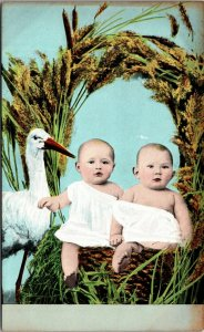 TWO BABIES in A BASKET w/ STORK ANTIQUE POSTCARD - VINTAGE POSTED