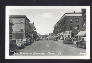RPPC PERRY IOWA DOWNTOWN STREET SCENE 1930's CARS VINTAGE REAL PHOTO POSTCARD
