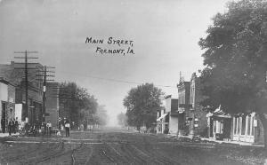 Fremont Iowa~Dirt Main St~Restaurants~Utility Poles~Gathered Folks RPPC 1913 PC